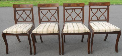Set of Four Regency Style Mahogany Sabre Leg Dining Chairs